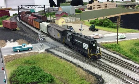 A local Penn Central freight halts traffic as it crosses Willow Springs Road. The Geep belongs to Matt Kosic. Photo by Bob Kosic.