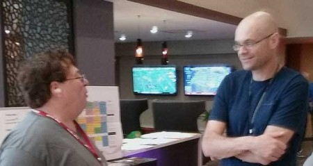 "Here are two resin freight car producers in casual conversation at Cocoa Beach. On the left is Steve Funaro and Ted Culotta is at the right. Aaron Gjermundson snapped the photo. It's a bit fuzzy as all three were ""resinating"" at the time."