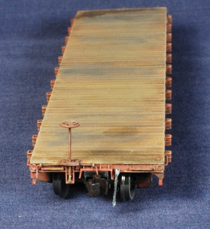 A Tichy flat car with uncoupling lever, Hi-Tech Details, and Accurail Proto:HO couplers.