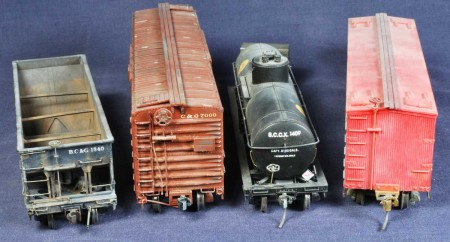 These freight cars have three different couplers installed. At the far right are Kadee #5 with Kadee #58 on the middle two cars. The trip pin has been snipped on the C&O box car. The hopper at left has Accurail Proto:HO couplers installed without the trip pin.