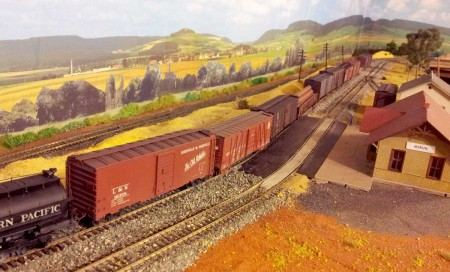 Four resin freight car kits are among the consist of this train on Paul Doggett's layout.