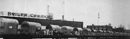 A line of boiler loads on flat cars ready to ship from the Kewanee plant. The company made a few types of boiler designs, as can be seen by the varied loads.